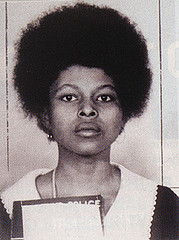 The image of Assata Shakur, the Castro-protected fugitive, that wallpapers Hill's Twitter page.